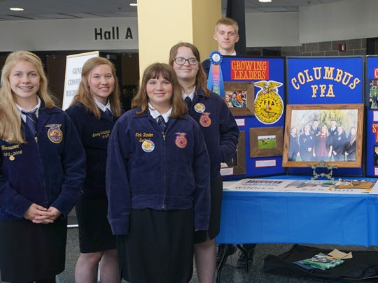 Columbus FFA chapter was asked to prepare a display sharing the chapter's story at the Wisconsin Association of FFA's state FFA convention. The FFA members pictured include (L to R) Emma Paulson, Lacey Schleicher, Sara Witzel, Kathryn Witzel, and Colin Damm. Not pictured: Kyle Paulson, Hailey Schoenherr, Abbygail Hayes, and Jessica Lins.