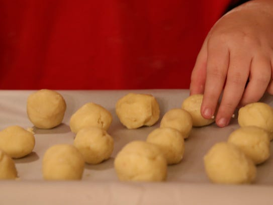 Chloe Lydon, 11 makes holiday themed cookies with a