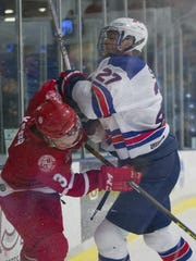 NTDP forward Keenan Suthers (No. 27) lays a hit on a Dubuque player during Friday night's United States Hockey League game.