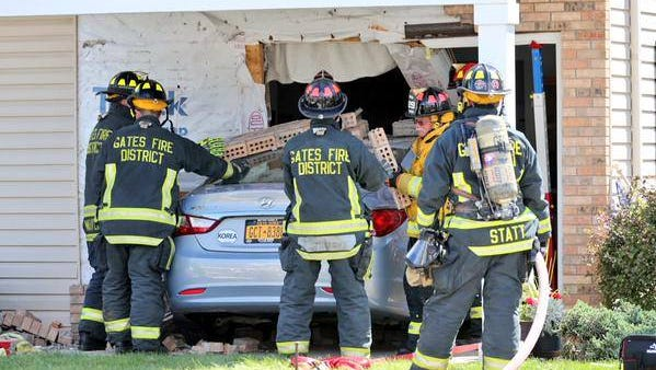 Gates firefighters rescue a couple who crashed into an apartment complex Monday.