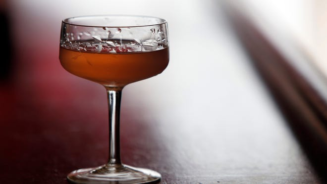 A Pink Gin, a re-mix on the classic version, made by James Bumbery at Pour Cafe and Wine Bar April 6, 2015 in Mount Kisco. Re-Mix: Substitute Angostura bitters with Peychaud's bitters.