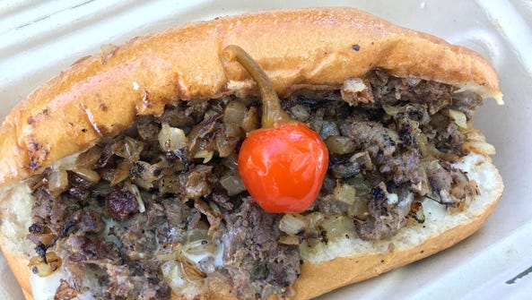 A Philly cheesesteak prepared by Brunch Bros. BBQ in