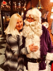 Purple Santa – Just after the Purple Aces skimmed by Austin Peay, Purple Santa left Ford Center and walked down Main Street, meeting and greeting in the holiday spirit. We overheard Krista Lockyear assuring Santa that she had been a very good girl this past year.