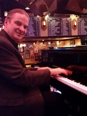 Pete Peterson plays the piano at Jeff Ruby's Steakhouse.