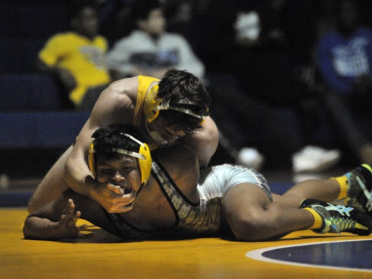 Sussex Central's Justin Bennett grapples with Cape's