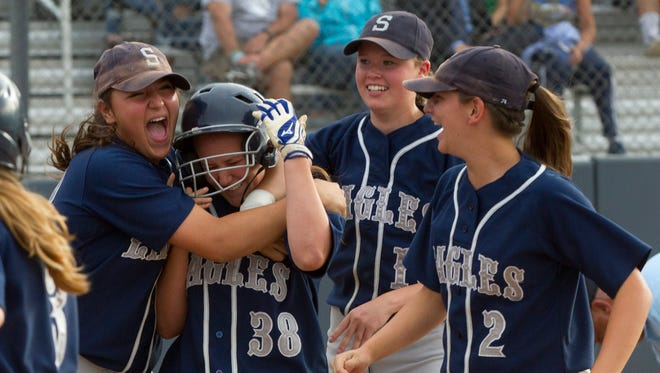Julia Blarr is mobbed by teammates after hitting a two run homer to give her team a 2-0 lead to start off the game. Middletown South vs Sparta in NJSIAA Group III final In Union NJ on  June 5  2015.  Peter Ackerman/Staff Photographer