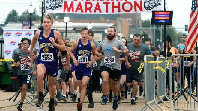 Booneville High School runner Austin Hill (2583) leads the pack at the start of the 5K race during the 52nd Annual Arkansas Marathon on Saturday morning, Oct. 10, 2020, in Booneville. The event included the full marathon, half-marathon 10K run, & 5K run and walk. Hill won the 5K with a time of 18:40.