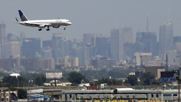 A United Airlines plane prepares to land at Newark