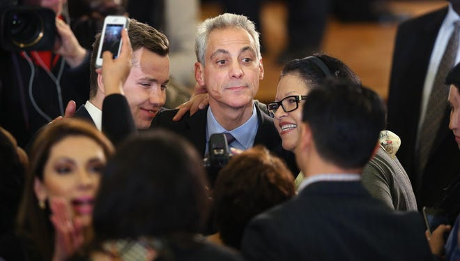 Chicago Mayor Rahm Emanuel greets supporters at an election day rally February 24, 2015, in Chicago.