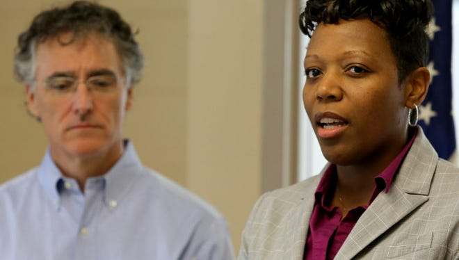 Cook County Sheriff Tom Dart looks on as Nneka Jones, right, a psychologist and the new head of the Cook County Jail, speaks to the media on May 19, 2015 in Chicago.