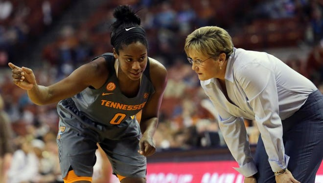 Tennessee point guard Jordan Reynolds, left, and coach Holly Warlick speak during a time out in the second half Sunday against Texas in Austin, Texas.