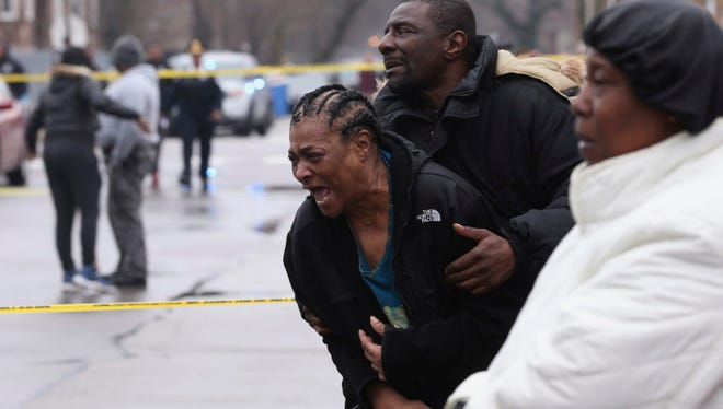 Georgia Jackson, 72, is overcome with emotion upon learning that her two grandsons, Raheem, 19, and Dillon Jackson, 20, were found fatally shot in the South Shore neighborhood in Chicago on Thursday, March 30, 2017.