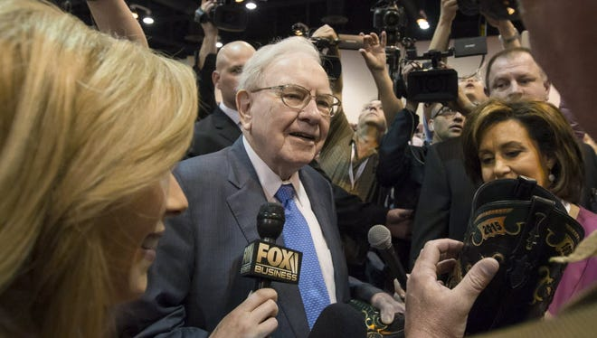 Berkshire Hathaway Chairman and President Warren Buffett is surrounded by investors and media at the company's annual shareholder meeting in 2015.