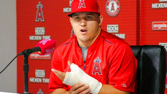 Los Angeles Angels' Mike Trout speaks about his injured left thumb during a news conference prior to the team's baseball game against the Detroit Tigers in Anaheim, Calif. American League MVP Trout will miss the All-Star Game while rehabilitating the thumb. (AP Photo/Mark J. Terrill, File)