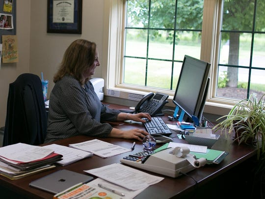Anne Hodges works at Pittsford Federal Credit Union in Mendon on Thursday, July 23, 2015.
