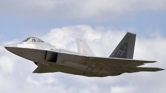 A F-22 Raptor makes a low pass during the EAA AirVenture 2015 Airshow at Wittman Regional Airport Tuesday, July 21, 2015, in Oshkosh.