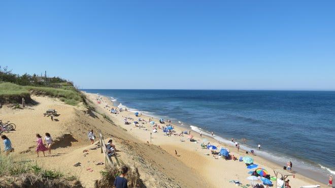 Beachgoers take to Lecount Hollow Beach in Wellfleet. The Wellfleet Select Board voted last week to extend the beach sticker season until Sept. 27.