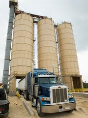 A truck leaves the Superior Silica Sands mine after