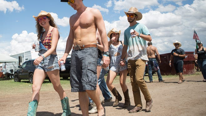 Festival-goers walk through campgrounds during Day 2 of Country Thunder on Friday, April 8, 2016, in Florence.