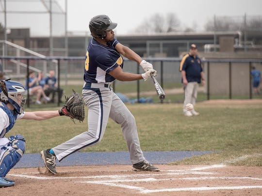 Wayne Memorial's Anthony Gray connects on a pitch during