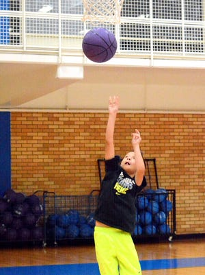 Ricky Fuentes, 8, attempts a layup during the Cavemen basketball camp on Wednesday.