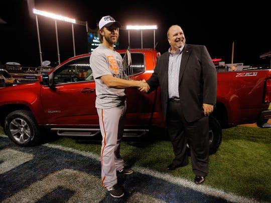 Chevrolet's Rikk Wilde presented Giants pitcher Madison