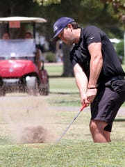 Albuquerque resident Levi Flores hits out of a bunker