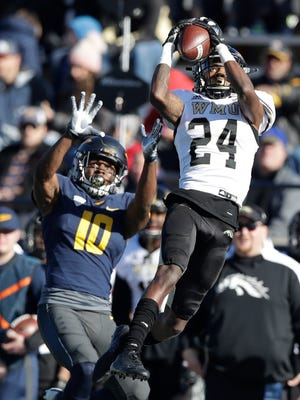 Western Michigan defensive back Obbie Jackson (24) intercepts a pass intended for Toledo wide receiver Desmond Phillips (10) during the first half of an NCAA college football game, Friday, Nov. 24, 2017, in Toledo, Ohio.