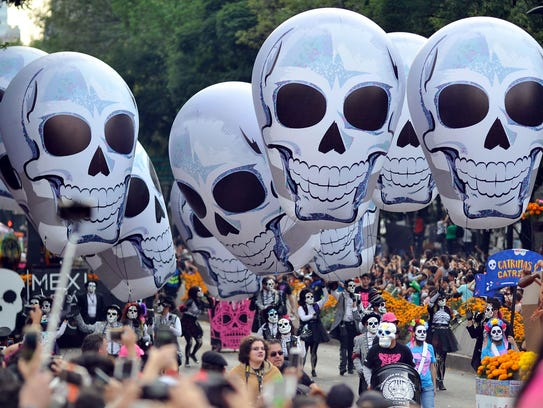 People take part in the Day of the Dead parade in Mexico