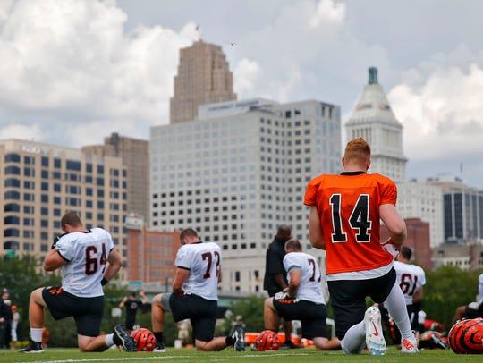 Cincinnati Bengals quarterback Andy Dalton (14), right,
