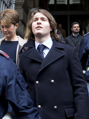 Raffaele Sollecito leaves Italy's highest court building in Rome, Italy, 27 March 2015. American Amanda Knox and her Italian ex-boyfriend expect to learn their fate Friday when Italy's highest court hears their appeal of their guilty verdicts in the brutal 2007 murder of Knox's British roommate Meredith Kercher. (AP Photo/Massimo Percossi, ANSA) ITALY OUT