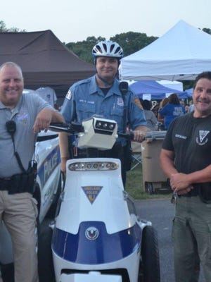 Charles Amadei (center on the personal transporter) pictured during a recent Vineland Police National Night Out celebration.