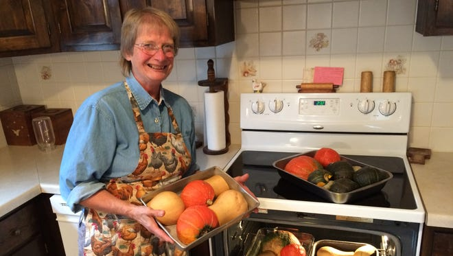 Susie Herland prepares squash for the upcoming Thanksgiving Day meal at the United Methodist Church of Sturgeon Bay.