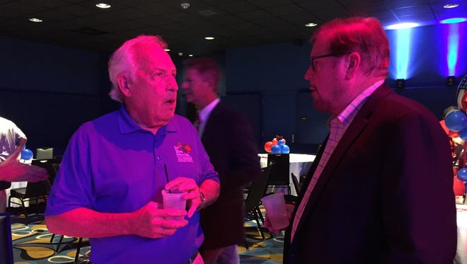 Hot air balloon world record holder Dr. Bill Bussey, left, visits with Ark-La-Tex Sports Museum board president Dr. George Bakowski during Wednesday's reception at Margaritaville Resort Casino.