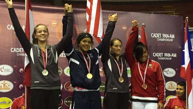 Denmark junior Jayden Laurent, left center, competed for the U.S. Cadet women's freestyle wrestling team at the Pan-American tournament on July 3 and placed first in the 143-pound weight class. She was one of 10 individuals on the U.S. Cadet women's team competing at the event.