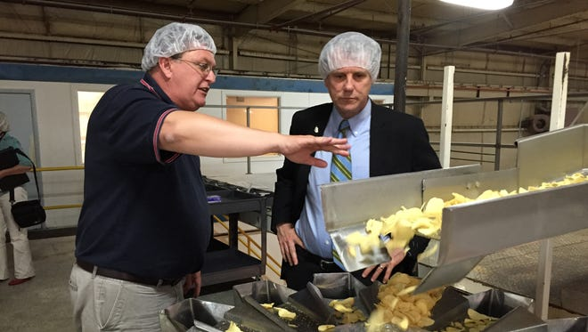 Jones Potato Chips Vice President Darryl Jones explains how chips are made Monday at the plant on Bowman Street in Mansfield.