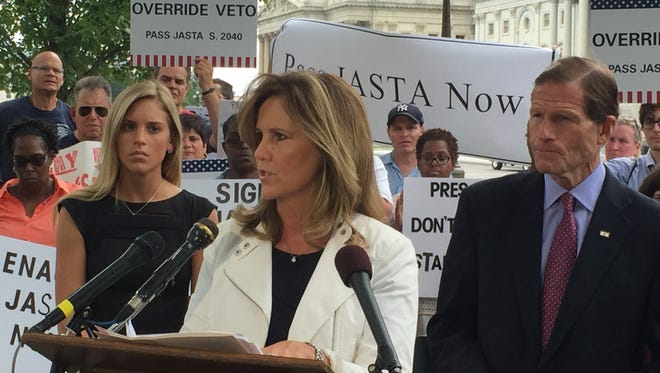 Terry Strada, national chairwoman of 9/11 Families and Survivors United for Justice Against Terrorism, speaks outside the U.S. Capitol on Sept. 20, 2016, urging President Obama to sign the Justice Against Sponsors of Terrorism Act.She is flanked by her daughter, Kaitlyn Strada, and Sen. Richard Blumenthal, D-Conn.