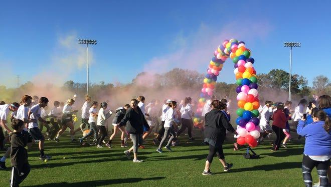 Pope John Paul II High School's colorful Caldwell Classic 5k raised $9,000 for The Jason Foundation.