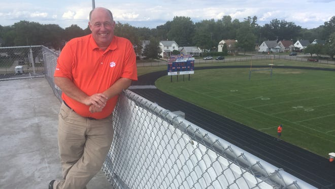 Dan York stands on the roof of his home away from home -- the press box at Garden City High School.