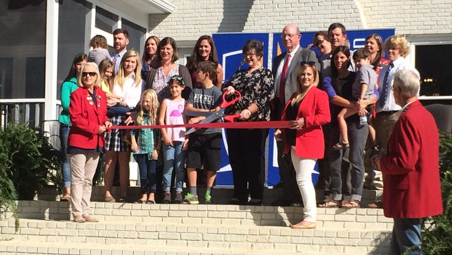 The family of the namesake of the Mignon and Harry Shelly Fine Arts Center poses for a photo with leaders from Jackson Christian at the ribbon cutting on Friday.