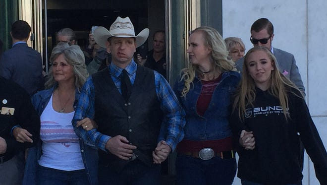 Ryan Bundy, with family members, walks out of the federal courthouse in Las Vegas on Dec. 20, 2017.