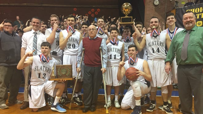 Fair Haven poses with the trophy following its 59-57 win over Milton in the Division II high school boys basketball championship game at Barre Auditorium on Monday night.