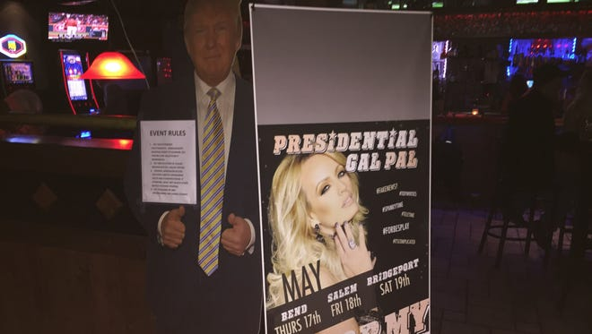 A cardboard cutout of President Trump is next to a Stormy Daniels poster at Stars Cabaret on Friday night, May 18, 2017.