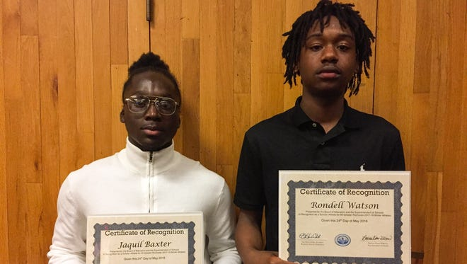AGR winter selections Jaquil Baxter (left) of Edison, Rondell Watson (right) of Leadership and Dyaisha Fair (not pictured) of Edison were honored by the Rochester Board of Education on Thursday, May 24.
