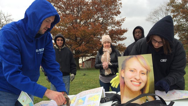 Friends and family search last week for Chelsea Bruck, 22, of Monroe County, who disappeared early in the morning of Oct. 26 while at a Halloween costume party.