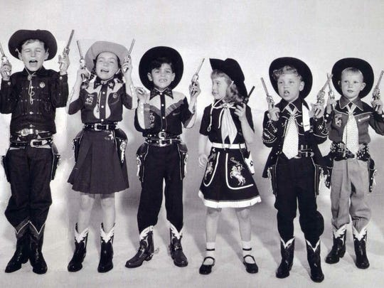 Young Hopalong Cassidy fans display their enthusiasm for their hero in this photo, circa 1950. Many of the earliest TV Westerns were aimed at children.