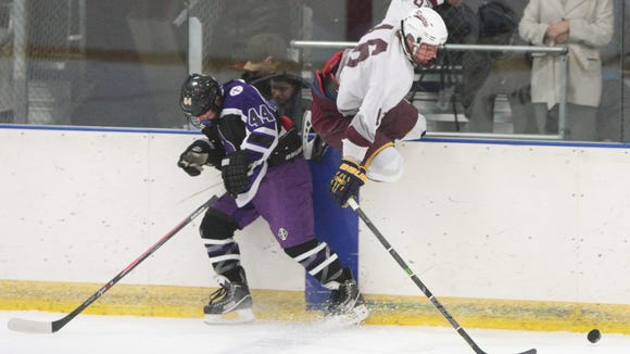 Scarsdale's James Nicholas avoids the check on board