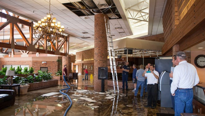 Clean-up crews respond to a ceiling collapse at the Red Lion Hotel Friday, April 29, 2016.