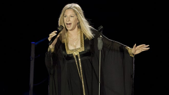 Singer Barbra Streisand performs during her concert in Tel Aviv, Israel on June 20, 2013.  Streisand is set to publish her long-discussed and long-promised memoir. The legendary singer-actress-filmmaker has a deal with Viking for her life story, the publisher announced Wednesday, May 20, 2015. The book is currently untitled and scheduled for 2017.