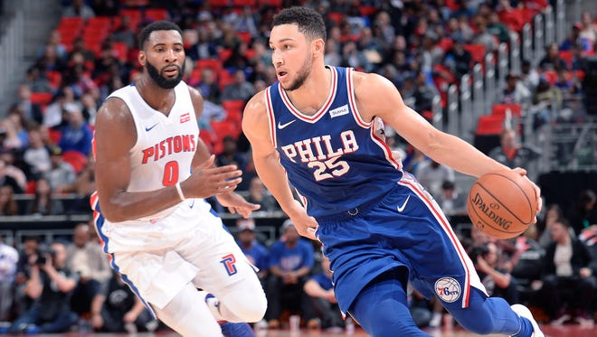 76ers' Ben Simmons drives around Pistons' Andre Drummond in the third quarter. Simmons a posted triple-double to help lead Philadelphia to a 97-86 win.